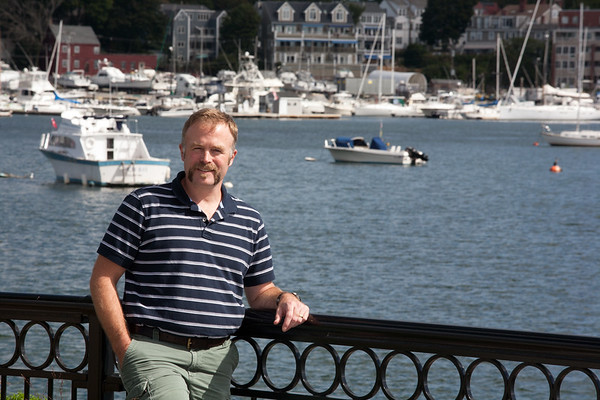 AMY SWEENEY/Staff photo.  Salem State University geologist Brad Hubeny stands with the Beverly Harbor behind him.  9/15/16