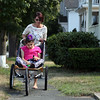 DAVID LE/Staff photo.<br />  Carol Amore, of Beverly, walks her daughter Sarah Carr, down Corning Street near their house. 8/18/16.