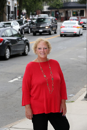 KEN YUSZKUS/Staff photo.     Bevery Main Streets executive director Gin Wallace on Cabot Street in Beverly.    09/09/16