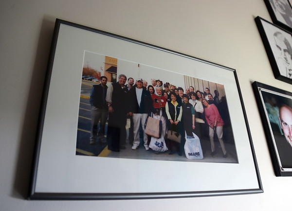 DAVID LE/Staff photo. An old photo for Designer Bath and Salem Plumbing Supply hangs on one of the walls in the store.