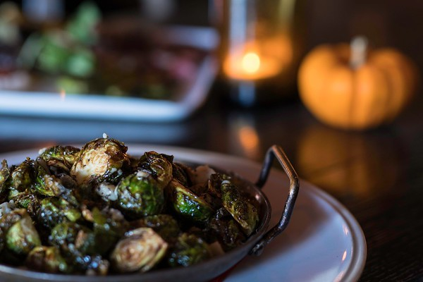 Brussels Sprouts with Apple Cider Reduction, Herbs, and Bleu Cheese at the Wild Horse Cafe.<br /> <br /> Photo by Don Toothaker