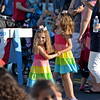 RYAN HUTTON/ Staff photo<br /> Irina Andrinopoulos, 5, right, and her sister Kiki, 3, left, dance during Danvers' annual Oldies Night block party on Maple Street on Thursday night.