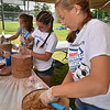 Danvers High School students (l-r) Becky Henion, Shannon Treacy, adn Jessica Barthlemess work to fill ice cream cups for the Danvers Scoop-Ahh-Bowl at the Danvers Family Festival.<br /> <br /> Photo by JoeBrownPhotos.com