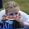 Lookiing to the judge to see if she was the winner of her heat of the Watermelon eating competition is Kaitlyn JaJuga of Methuen at the Danvers Family Festival.<br /> <br /> Photo by JoeBrownPhotos.com