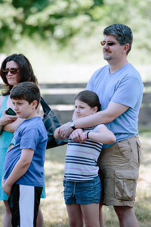JARED CHARNEY/ Photo. Misha, Heather, Zack, & Lucy Drench watch WWI re-eanactors perform drills at the 5th Annual Gala at the Rebecca Nurse Homestead in Danvers, Saturday, June 25, 2016.