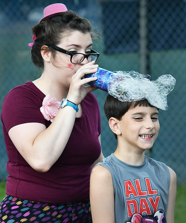 "Silly Kristen (l) prepares Groveland's Sam Bachand, 8 for his ""bubble haircut"" during the Danvers Family Festival.<br /> <br /> Photo by JoeBrownPhotos.com"