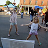 RYAN HUTTON/ Staff photo<br /> Sofia Panagoulias, 10, left, and her sister Hope, 7, compete in a jumping jack contest sponsored by the YMCA during Danvers' annual Oldies Night block party on Maple Street on Thursday night.