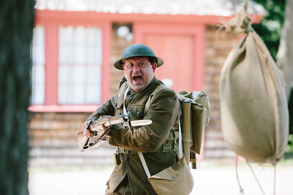 JARED CHARNEY/ Photo. Chris Benedetto, a WWI re-eanactor demonstrates a training exercise at the 5th Annual Gala at the Rebecca Nurse Homestead in Danvers, Saturday, June 25, 2016.