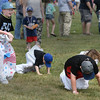 Tyler Chisholm (left) 8 years old, is the only one left standing and would ultimately win this heat of the classic Sack Race, held at the Danvers Family Festival at Plains Park. <br /> <br /> Photo by JoeBrownPhotos.com