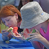 10 year old Zoe Roldan (r) and Caitlin Corrigfan, who are visiting the Danvers area from NYC for the 4th of July, competed against each other in one of the several watermelon eating competitions! <br /> <br /> Photo by JoeBrownPhotos.com