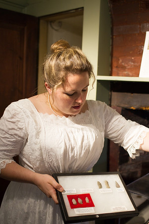 JARED CHARNEY/ Photo. Kathryn Rutkowski shows off arrowheads found on the property at the 5th Annual Gala at the Rebecca Nurse Homestead in Danvers, Saturday, June 25, 2016.