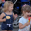 RYAN HUTTON/ Staff photo<br /> Harlow Irdens, 2, left, and her friend Georgina Wellers, 3, enjoy some ice cream during Danvers' annual Oldies Night block party on Maple Street on Thursday night.