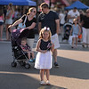 RYAN HUTTON/ Staff photo<br /> Abigail Sullivan, 5, waits for her family to catch up as they head down Maple Street during Danvers' annual Oldies Night block party on Thursday night.