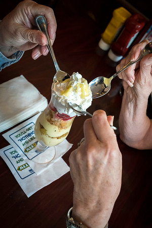 Customers share a strawberry and pineapple trifle a sweet ending to their American fare food at the Osborn Tavern in Danvers.