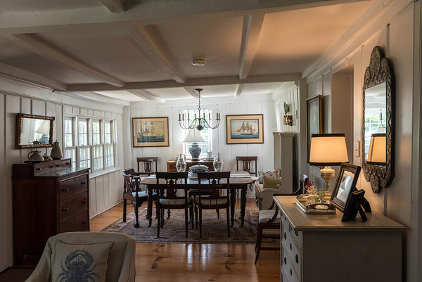 The so-called keeping room serves as the dining room and a casual seating area. The deliberately-chosen light paint colors make the old house feel light and fresh, adjectives not typically associated with old homes.