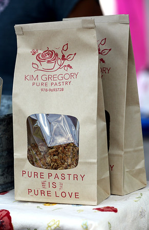 KEN YUSZKUS/Staff photo. Maple granola brittle at Kim Gregory Pure Pastry booth at the Danvers Farmers Market.  07/06/16