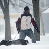 Ray T, of Salem, and his dog Nietzsch, go for a walk in the deep snow at Lafayette Park in Salem on Tuesday morning. DAVID LE/Staff photo. 1/27/15.