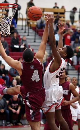 KEN YUSZKUS/Staff photo.   Salem's Jhonel Roberts tries for the rebound during the Lynn English at Salem High boys basketball game.  01/05/15