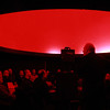 Mr. Howard Murphy, teacher of astronomy at Peabody High School, addresses a full room inside the newly renovated Planetarium on Tuesday evening. DAVID LE/Staff photo. 1/13/15.