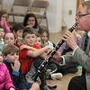 KEN YUSZKUS/Staff photo. Cape Ann Symphony's David Benjamin demonstrates the clarinet to the Glen Urquhart School 2nd and 3rd graders.   01/15/15