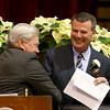 MARY SCHWALM/Staff photo  Incoming City Council President Thomas Walsh, right, shakes hands with outgoing president Robert Driscoll during the Peabody State of the City address and city council reorganization at the Wiggins Auditorium at City Hall in Peabody. 1/5/15