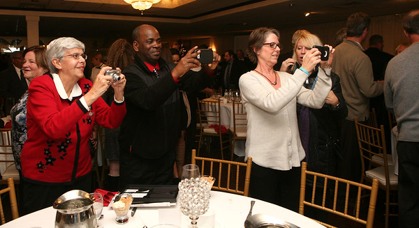 AMY SWEENEY/Staff photo. Friends and family members take photos of their all-stars after The Salem News 2016 High School Football All-Stars banquet held at Danversport Yacht club. 12/6/16