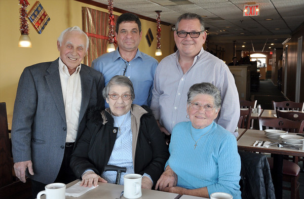 Left to right: Sam Ciruolo and his wife Antinnetta, his son<br /> Anthony Ciruolo, Ralph Calitris and his mother Anna (Joe Calitris's wife) at Sam and Joe's Restaurant in Danvers.<br /> Photo by Kathy Chapman.