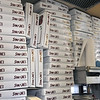 Stacks of pizza boxes ready to be filled atSam and Joe's Restaurant.<br /> Photo by Kathy Chapman