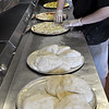 Pizza being made  at Sam and Joe's Restaurant.<br /> Photo by Kathy Chapman.
