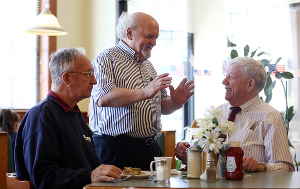 """DAVID LE/Staff photo. New Brother's Deli owner and """"unofficial Mayor of Danvers"""" Kary Andrinopoulos, center, talks with Peabody native Arthur Holden, of Holden Fuel and Oil, left, and Jack Good, right, who works in downtown Danvers. 4/15/16."""
