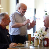 "DAVID LE/Staff photo. New Brother's Deli owner and ""unofficial Mayor of Danvers"" Kary Andrinopoulos, center, talks with Peabody native Arthur Holden, of Holden Fuel and Oil, left, and Jack Good, right, who works in downtown Danvers. 4/15/16."