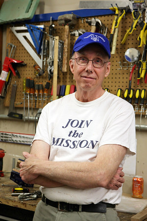 AMY SWEENEY/Staff photo.<br />  Jim Bennett, a retired minister, volunteers at Mission of Deeds in Reading.