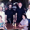"Pat Andrinopolous,  left with her husband Kyriakos ""Kary"" Andrinopolous, Father Harry Provakis, Father Andrew Demodsis, Kougianos, and Gloria at Brothers Restaurant in the 1990s."