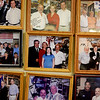 PAUL BILODEAU/Staff photo.  Kary Andrinopoulos of New Brothers Deli/Restaurant in Danvers wall of photos of local celebrities.