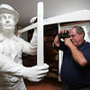 KEN YUSZKUS/Staff photo.     Danvers Historical Society vice president George Saluto photographs the wooden sculpture, the reaper, at Glen Magna.        09/14/16