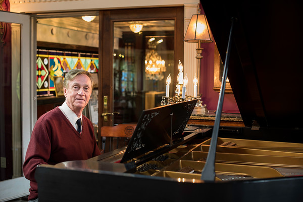 John Archer, an accomplished pianist, sits at his piano in his North Street home in Danvers.<br /> Photo by Don Toothaker
