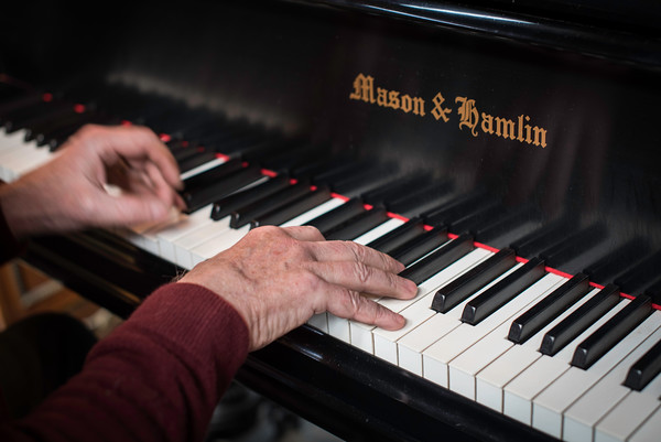 John Archer plays his Mason & Hamlin piano, which was built in 1880.