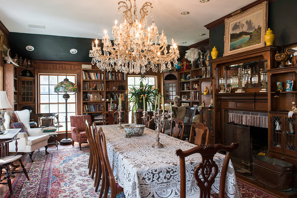 The dining room at John Archer's. He displays porcelain pieces collected in China, African carvings, masks from New Guinea, and a massive crystal chandelier purchased in Buenos Aires.