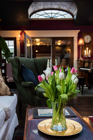 Tulips decorate a table in the music room of John Archers home.<br /> ony.
