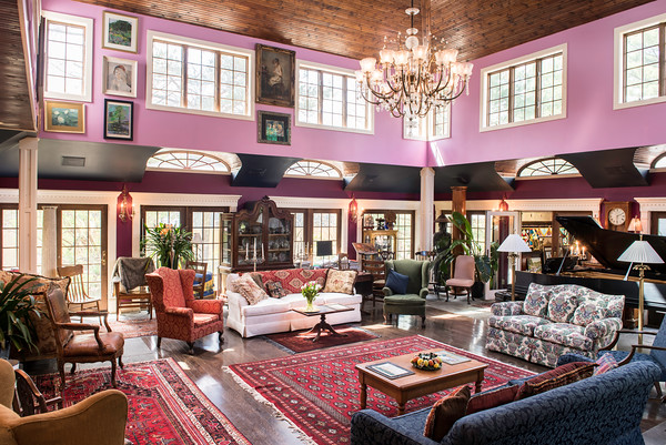 """The center of the John Archer's home is the ballroom sized """"music room,"""" its ceiling nearly three stories above. You can sit and watch dancers whirl from a second floor balc<br /> His sprawling 1898 home has been expanded dramatically, from 3,000 square feet to more than 12,000. <br /> As he takes yo"""