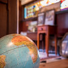 "A globe in the sunkin living room at John Archer's Danvers home. He has visited places as exotic as Myanmar or Siberia. <br /> ""I've visited many countries in the world."" Archer said."