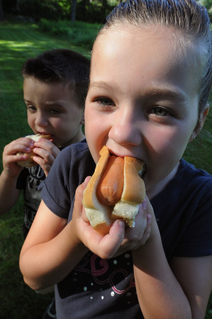 FILE PHOTO<br /> Reese MacDonald (right), and her brother Maddox, enjoy their hot dogs at the Danvers Family Festival in 2011.