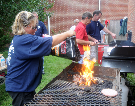 Wenham: Erica Ciampa puts charcoal in the grill  at the annual  BBQ at the Wenham fire station Saturday morning during <br /> Wenham Museum's 39th annual Family Festival and Craft Fair<br /> <br /> <br />  Jim Vaiknoras/Staff photo