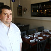 KEN YUSZKUS/Staff photo.     Nine Elm American Bistro restaurant owner Matt Sanidas.     04/14/16