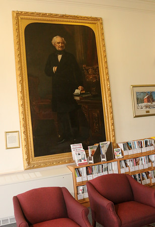 Photo by Allegra Boverman. In the Standing Room patrons can sit and read magazines on a couch, look at the fireplace or beautiful view of the pond. A portrait of George Peabody  has hung in that exact spot since 1892.