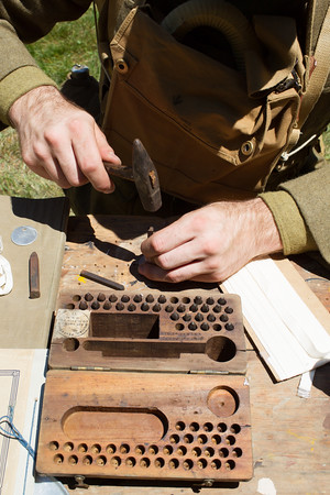 JARED CHARNEY/ Photo. Matt Payson, a WWI reeanactor creates a Dog Tag at the 5th Annual Gala at the Rebecca Nurse Homestead in Danvers, Saturday, June 25, 2016.