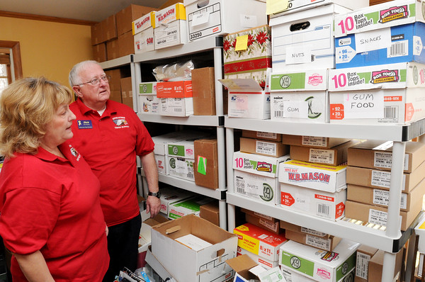 Danvers: Christine and Dick Moody are founders of Operation Troop Support. They are standing near some of the boxes of supplies they use to fill the packages going to the troops. Photo by Ken Yuszkus/The Salem News, Friday, March 15, 2013.