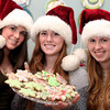 AMY SWEENEY/Staff photo<br /> <br /> Carolyn Larsen, 16, left, Sophie Cawlina, 19, and Alena Larsen, 19, decorate Christmas cookies at the Cawlina home in Danvers.<br />  10/9/16