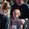 Jared Charney / Photo Bruce Talbot (husband of the late Lynda Talbot) congratulates his granddaughter Brooke Bazylinski after finishing the 6th Annual Lynda J. Talbot 5K run/walk, Sunday, September 21, 2016.