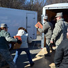 Girls Scouts help load the truck of cookies that will be sent to the troops through Operation Troop Support.